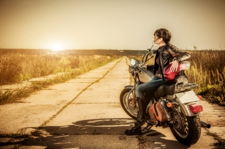 Biker girl sits on a motorcycle Stock Photo - 15831858