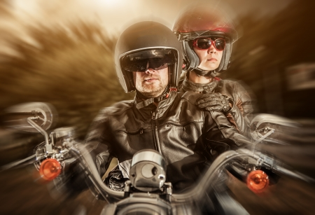 Biker man and girl sits on a bike Stock Photo - 15831820