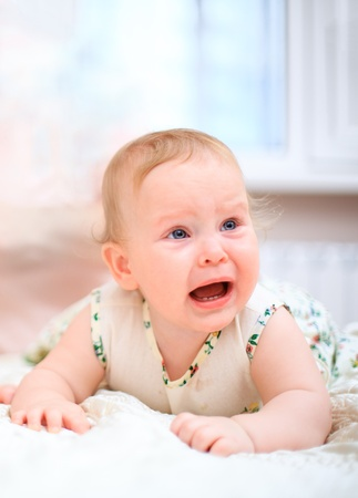 crying baby: Crying baby on a light background