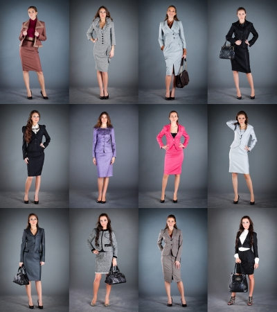 suit skirt: Collection of womens business suits on a dark background Stock Photo