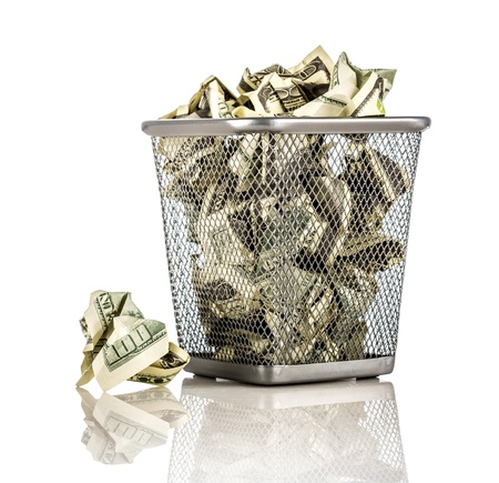 bucket of money: Money in a basket on a white background Stock Photo