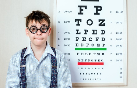 myopia: person wearing spectacles in an office at the doctor