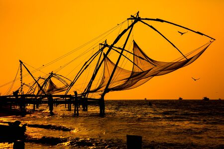india fisherman: Chinese fishnets, Cochin South India. Stock Photo