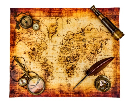 history: Vintage magnifying glass, compass, goose quill pen, spyglass and a pocket watch lying on an old map isolated on white. Stock Photo