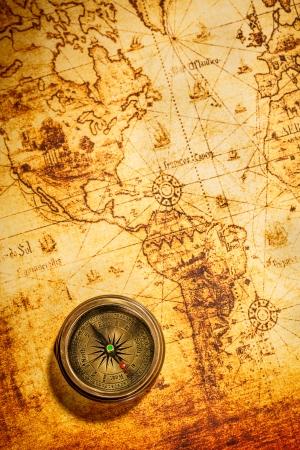 map compass: Vintage still life. Vintage compass lies on an ancient world map.