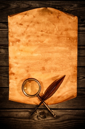 bygone: Blank old paper with curled edge against the background of an aged wood