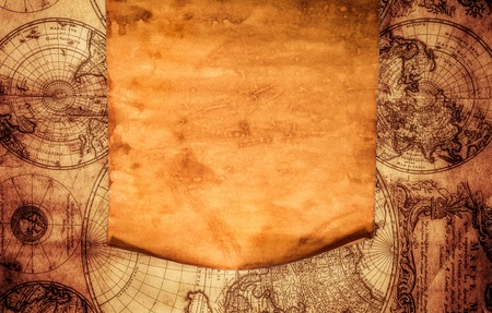 Blank old paper with curled edge against the background of an ancient map photo