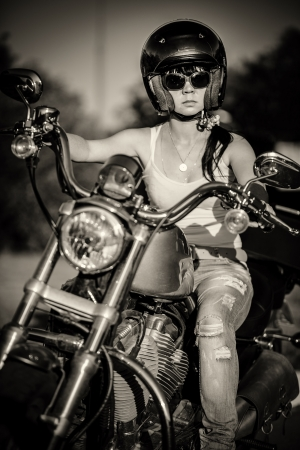 Biker girl sits on a motorcycle Stock Photo - 19537175