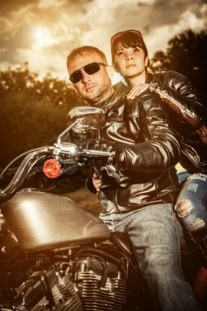 Biker couple, man and woman in leather jacket on a motorcycle  photo