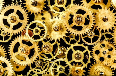 gearing: close up old mechanism on a black background