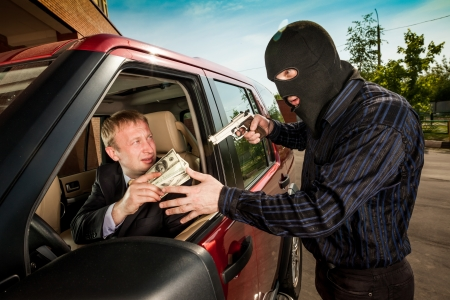 housebreaking: Robbery of the businessman in its car Stock Photo