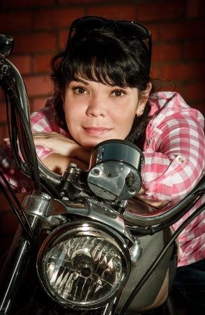 Real biker girl sits on a motorcycle Stock Photo - 20151037