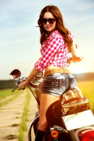 Biker girl with sunglasses sitting on motorcycle Stock Photo - 20151035