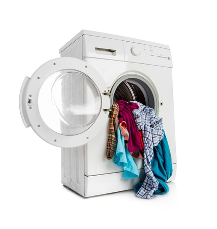 wet clothes: Washing machine with clean linen on a white background