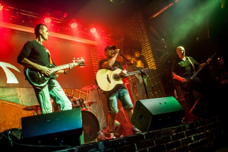 Band performs on stage, rock music