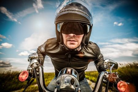 Biker in sunglasses and leather jacket racing on the road  fisheye lens  Zdjęcie Seryjne