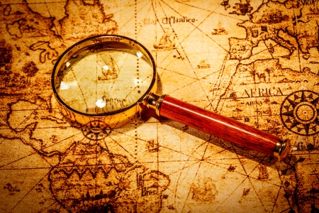 sea world: Vintage still life. Vintage magnifying glass lies on an ancient world map