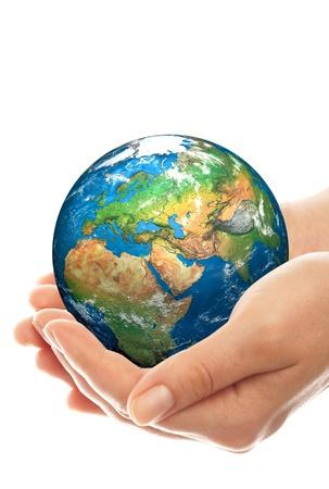 Human hand holding a globe. photo