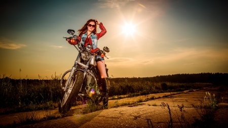 biker girl: Biker girl with sunglasses sitting on motorcycle