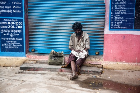 widespread: THANJAVUR, INDIA - FEBRUARY 14: Beggar sitting on a street February 14, 2013 in Thanjavur, India. Poverty in India is widespread, with the nation estimated to have a third of the worlds poor. Editorial