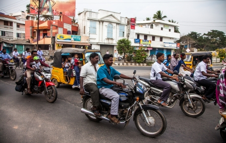 motor bike: THANJAVUR, INDIA - FEBRUARY 13: Indian riders ride motorbikes on busy road on February 13, 2010 in Thanjavur, India. Motorbike is the most favorite vehicle and most affordable for India.