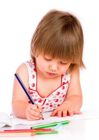 Little baby girl draws pencil isolated on white background. photo