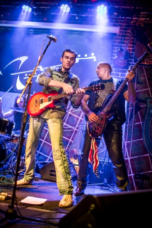 Band performs on stage, rock music concert photo