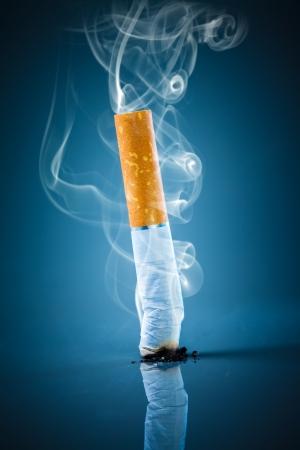 no smoking sign: No smoking. Cigarette butt on a blue background. Stock Photo