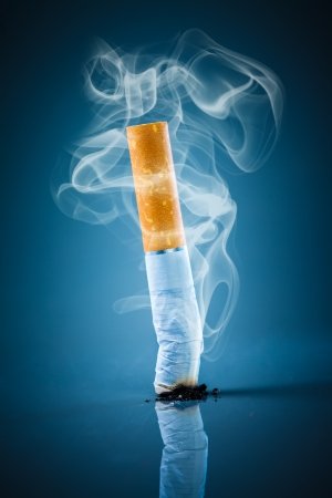 no: No smoking. Cigarette butt on a blue background. Stock Photo