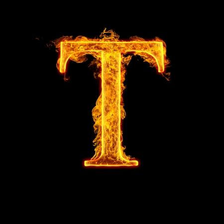 resplandor: Fuego alfabeto letra T aisladas sobre fondo negro. Foto de archivo