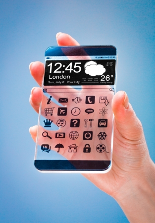 Smartphone (phablet) with a transparent display in human hands on a blue background. Concept actual future innovative ideas and best technologies humanity. photo
