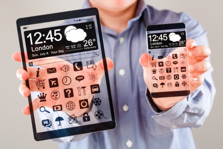 actual: Smartphone (phablet) and tablet with a transparent display in human hands. Concept actual future innovative ideas and best technologies humanity.