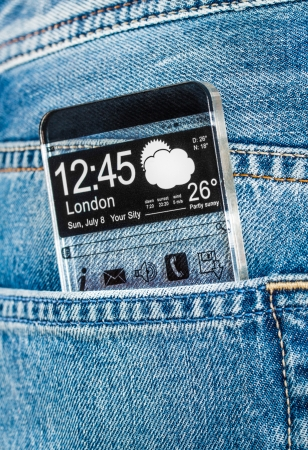 Smartphone (phablet) with a transparent display in a pocket of jeans. Concept actual future innovative ideas and best technologies humanity. photo