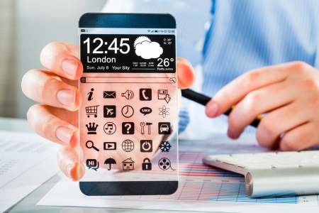 mobile communication: Smartphone (phablet) with a transparent display in human hands. Concept actual future innovative ideas and best technologies humanity.