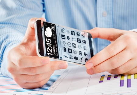 Smartphone (phablet) with a transparent display in human hands. Concept actual future innovative ideas and best technologies humanity. Stock Photo - 25197508