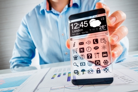 Smartphone (phablet) with a transparent display in human hands. Concept actual future innovative ideas and best technologies humanity. Stock Photo - 25197646
