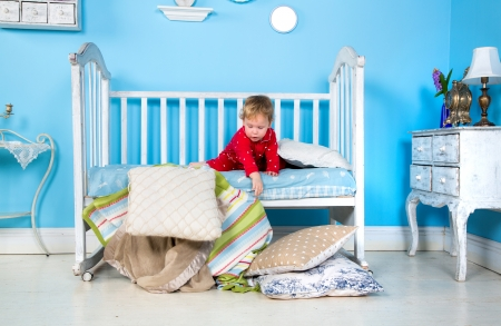 baby bed: Baby playing on bed Stock Photo