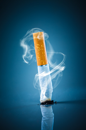 No smoking. Cigarette butt on a blue background. Stock Photo
