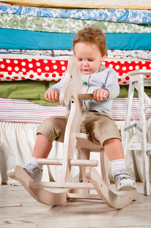 Child play with a wooden Rocking Toy horse pony. Stock Photo - 25194986