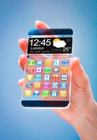 actual: Smartphone (phablet) with a transparent display in human hands on a blue background. Concept actual future innovative ideas and best technologies humanity. Stock Photo