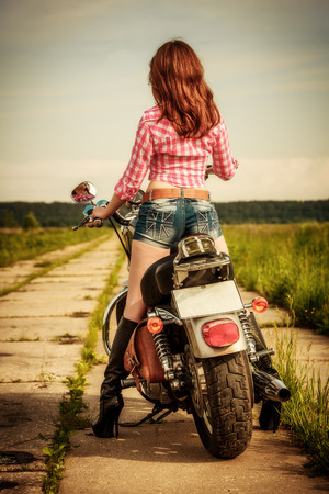 rebel: Biker girl with sunglasses and motorcycle