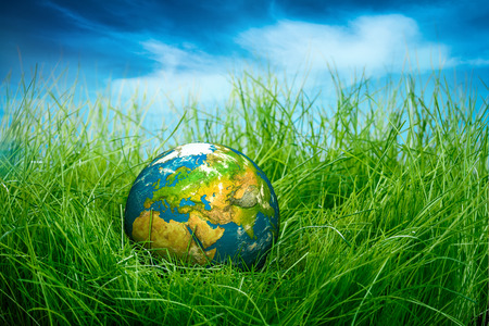 globe asia: Globe lies on green grass. Concept - Earth Day.