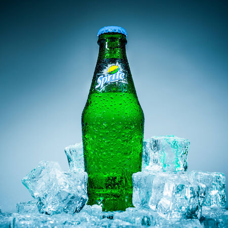 popularity: MOSCOW, RUSSIA-APRIL 4, 2014: Bottle of Coca Cola company soft drink Sprite on ice. It was introduced in the United States in 1961. This was Cokes response to the popularity of 7 Up.