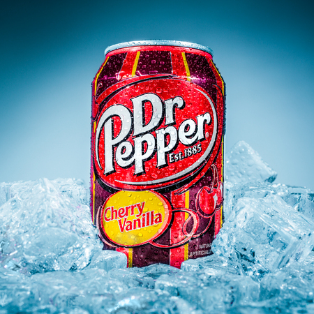 marketed: MOSCOW, RUSSIA-APRIL 4, 2014: Can of Dr Pepper Cherry Vanilla soft drink on ice. Dr Pepper is a soft drink marketed as having a unique flavor. The drink was created in the 1880s. Editorial