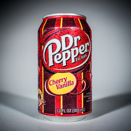marketed: MOSCOW, RUSSIA-APRIL 4, 2014: Can of Dr Pepper Cherry Vanilla soft drink. Dr Pepper is a soft drink marketed as having a unique flavor. The drink was created in the 1880s. Editorial