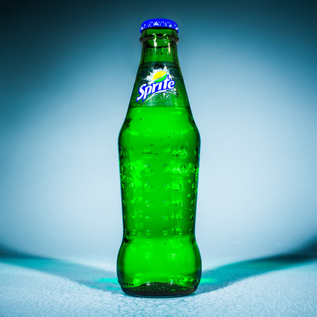 popularity: MOSCOW, RUSSIA-APRIL 4, 2014: Bottle of Coca Cola company soft drink Sprite. It was introduced in the United States in 1961. This was Cokes response to the popularity of 7 Up.
