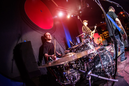 drum kit: musician playing drums on stage, rock music concert