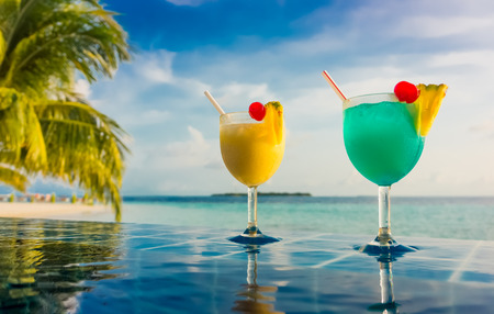 Cocktail near the swimming pool on the background of the Indian Ocean, Maldives. Stock Photo - 27988125