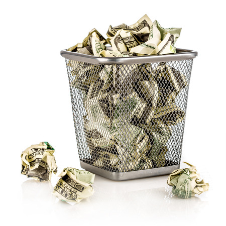 Money in a basket on a white background photo