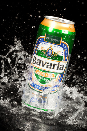 family owned: MOSCOW, RUSSIA-APRIL 4, 2014: Can of Bavaria Beer. Bavaria is the second largest brewery in the Netherlands. Founded in 1719 by Laurentius Moorees, it is currently owned by the Swinkels family.